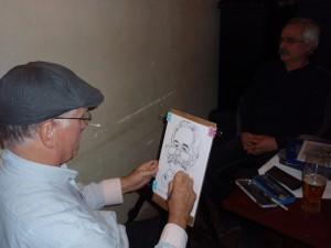 Diskuzní večer – jeden ze dvou přítomných karikaturistů při práci